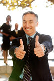Two Thumbs Up. A business man with thumbs up - critical focus on the thumbs Royalty Free Stock Image