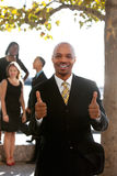 Two Thumbs Up. An african american business man with thumbs up Stock Images