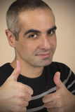 Two Thumbs Up. Portrait of a senior man with his two thumbs up Stock Photography
