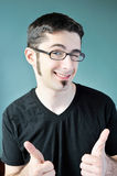 Two thumbs up. A young man giving two thumbs up in approval Royalty Free Stock Image