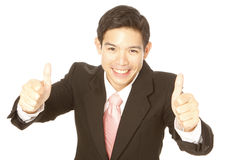 Two Thumbs Up. A young businessman with a two thumbs up sign (isolated on white Stock Photo