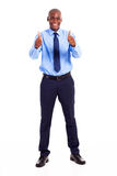 Two thumbs up. African businessman giving two thumbs up isolated on white Stock Photos