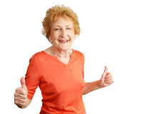 Two Thumbs-up. An enthusiastic red haired senior lady giving two thumbs up.  Isolated on white Royalty Free Stock Photos