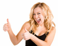 Two Thumbs Up. A beautiful blonde woman is showing her appreciation towards a job very well done Royalty Free Stock Photos