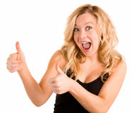 Two Thumbs Up. A beautiful blonde woman is showing her appreciation towards a job very well done Royalty Free Stock Photography