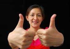 Two thumbs up. Chinese lady raising two thumbs up Royalty Free Stock Image