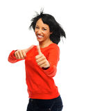 Two thumbs up with flying hair. Happy attractive girl with two thumbs up and windswept hair, shot in studio isolated on white Royalty Free Stock Photo