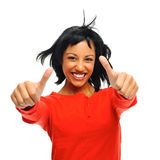 Two thumbs up with flying hair. Happy attractive girl with two thumbs up and windswept hair, shot in studio isolated on white Stock Image
