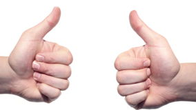 Two thumbs up isolated on a white background. Shot on Canon 5D Mark II with Prime L Lenses stock video footage