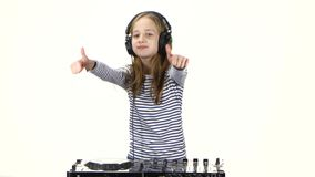 Two thumbs up shows girl teenager dj playing on vinyl. Dancing to music, hands playing on console, dressed in white blouse with stripes, model is visible to stock video footage