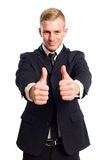 Two thumbs up for you. Portrait of young businessman showing two thumbs up for you Royalty Free Stock Photography