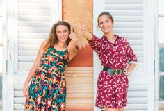 Two thumbs up by young girls. Two young best friend giving two thumbs up and approving royalty free stock photography