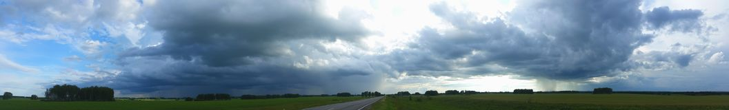 Two thunderstorms. Panorama. Was in a situation where on both sides of the road there were two thunderstorms. I could not drive past. Photographed royalty free stock images