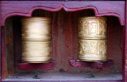 Two Tibetan Buddhist prayer wheels Royalty Free Stock Photo