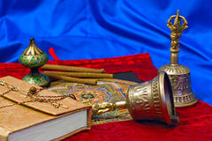 Two Tibetan ritual bell and a book Royalty Free Stock Images