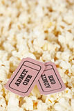 Two tickets on popcorn background. Shallow depth of field Royalty Free Stock Photo