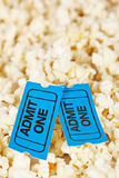 Two tickets on popcorn background. Shallow depth of field Royalty Free Stock Images