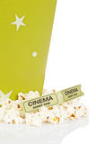 Two tickets and popcorn bucket. Popcorn bucket with two tickets isolated on a white background Stock Images