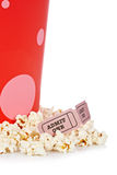 Two tickets and popcorn bucket. Popcorn bucket with two tickets isolated on a white background Stock Photography
