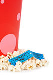 Two tickets and popcorn bucket. Popcorn bucket with two tickets isolated on a white background Royalty Free Stock Image