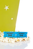 Two tickets and popcorn bucket. Popcorn bucket with two tickets isolated on a white background. Shallow depth of field Royalty Free Stock Photography