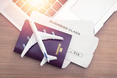 Two tickets are on the table with a laptop. buying online ticket booking for travel concept royalty free stock photo