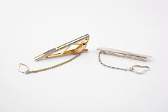 Two tie-clip. Metal and silver tie-clip on white background Royalty Free Stock Photo