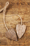 Two tied wooden hearts on old  wood Royalty Free Stock Photography