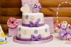 Two-tier birthday cake. Two-tier cake made of mastic decorated with bows for one year stock photography