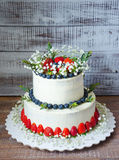 Two-tier cream cheese wedding cake with blueberries and strawber Royalty Free Stock Photo