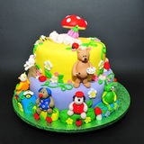 Two tier fondant cake for baptism celebration. Beautifully crafted cake with little animals fondant figurines Stock Photos