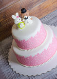 Two-tier fondant wedding lace cake with bear and bunny. A two-tier fondant wedding lace cake with bear and bunny stock images