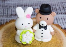 Two-tier fondant wedding lace cake with bear and bunny. A two-tier fondant wedding lace cake with bear and bunny royalty free stock image