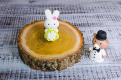 Two-tier fondant wedding lace cake with bear and bunny. A two-tier fondant wedding lace cake with bear and bunny stock image