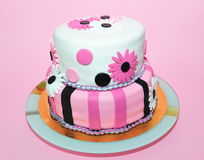 Two tier pink and white fondant cake Royalty Free Stock Photos