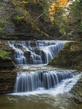Two-Tiered Falls on Upper Buttermilk Creek. Two-tiered falls on Buttermilk Creek in Buttermilk Falls State Park, NY Stock Images