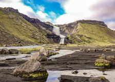 Two-tiered waterfall Ofaerufoss in the great fissure of volcanic canyon Eldgja in sunny weather royalty free stock image