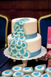 Two-tiered wedding cake with blue ribbons Royalty Free Stock Images