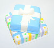 Two tiers colorful fondant cake as present. Two tiers square cake shaped like present boxes Stock Photo