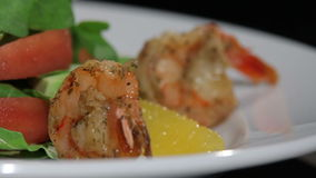 Two tiger prawns on a beautiful dish. Translation focus stock video footage