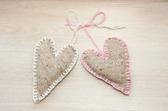 Two tighten self made linen hearts Royalty Free Stock Photo
