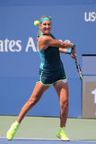 Two times Grand Slam champion Victoria Azarenka of Belarus in action during US Open 2015 second round match. NEW YORK - SEPTEMBER 3, 2015: Two times Grand Slam Stock Image