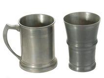 Two tin mugs. Antique tin mug isolated on white beckground Stock Images