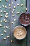 Two tipes of peanut butter Stock Images