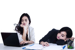 Two Tired Businesswomen Stock Photography
