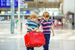 Two tired little sibling boys at the airport Royalty Free Stock Photo