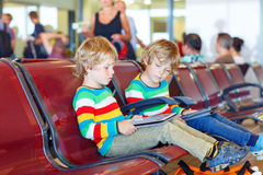 Two tired little sibling boys at the airport Royalty Free Stock Photography