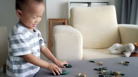 Child playing soldiers and figurine toys stock video footage