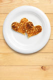 Two toast bread in the shape of hearts Royalty Free Stock Images