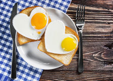 Two toast with scrambled eggs in the shape of a heart Stock Image